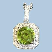 Custom Cut Peridot and diamond pendant in 14 karat white gold with chain