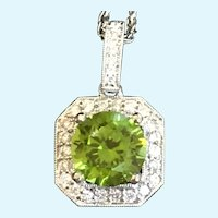 Custom Cut Peridot and diamond pendant in 14 karat white gold with chain