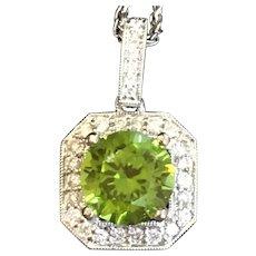 Custom Cut Peridot and diamond pendant in 14 karat white gold with 14 karat white chain