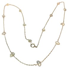 Vintage natural Mississippi river pearls on a 14 karat chain