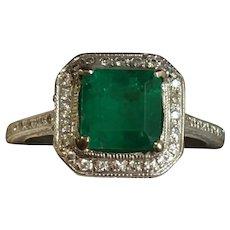 Vintage 18 karat white gold diamond and emerald ring