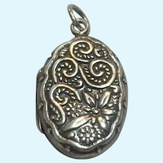 Vintage Sterling Silver repousse type locket