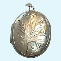 Vintage British sterling silver hand engraver locket