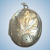 Vintage British sterling silver hand engraver locket