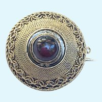 Victorian small brooch with garnet cabochon