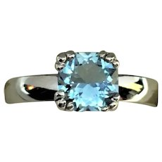 Custom made cushion cut aquamarine in 14 karat white ring