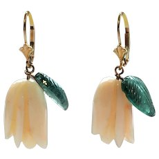 Angel skin coral flower buds with green carved tourmaline leaves on 14 karat gold leverback earrings
