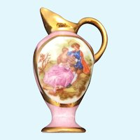 Limoges miniature rose colored water jug