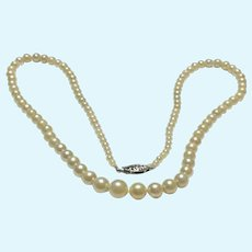Vintage 18 inch graduated cultured pearl necklace with 10 KT gold clasp