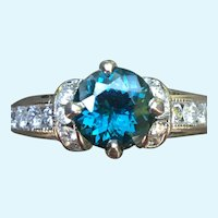 1.25 CT Natural teal diamond cut sapphire in 14 kt white and diamond engagement ring