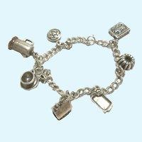 Vintage Sterling charm bracelet with seven vintage sterling charms
