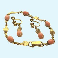 Natural pink coral bracelet and earrings in 12 K gold filled.