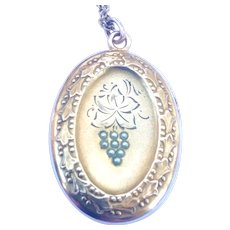 Victorian revival rolled gold locket with silver tones seed pearls