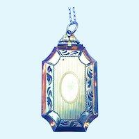 Victorian revival locket opens from bottom