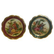 A pair of Limoges Courting couple miniature plates