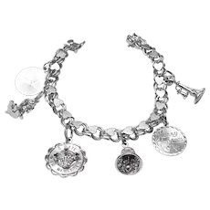 Vintage Elco sterling silver charm bracelet with six sterling charms