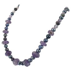 Amethyst bead and black cultured pearl necklace 14 karat white gold clasp