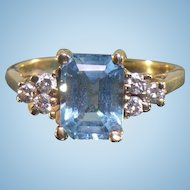 Vintage 14 karat Blue topaz and diamond ring