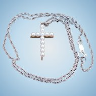 Vintage 14 karat gold and cultured pearl cross on a 14 karat gold chain