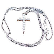 Vintage 14 karat white gold and pearl cross on a chain