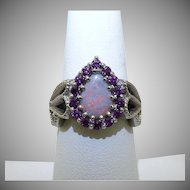 Custom 14 karat white gold Opal and Rhodolite garnet ring