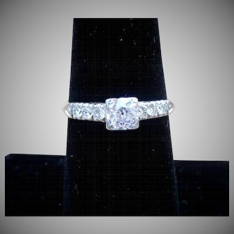 Vintage Platinum and Diamond ring with a European center diamond