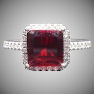 Garnet and diamond ring in 14 karat gold