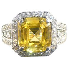 6.23 CT Yellow Sapphire and diamond ring in 14 karat white gold.