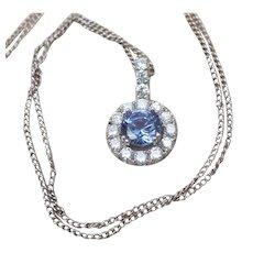 Violet sapphire and diamond pendant in 14 karat white gold.