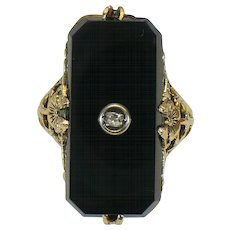 Victorian style Onyx and diamond ring in 10 karat gold.