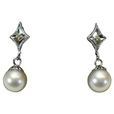 Vintage Akoya cultured 7.25 mm pearl and diamond earrings in 14 karat white gold