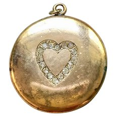 Vintage round locket with heart
