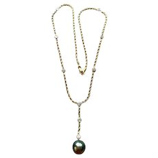 Vintage 18 KT gold Tahitian pearl and diamond necklace,1.12 CTW