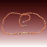 Vintage Natural Coral, Cultured pearl, and 14 karat gold necklace.