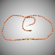 Vintage Natural Coral, Cultured pearl, and 14 karat gold necklace.