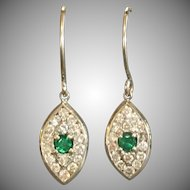 Custom made 14 kara white gold Emerald and diamond earrings
