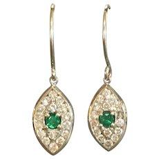 Custom made 14 kara white gold Emerald and diamond earrings
