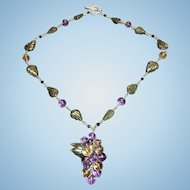 Sterling silver grape cluster necklace in amethyst, citrine, labradorite, and garnet.