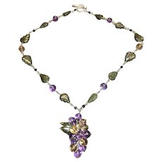 The  Sterling silver grape cluster necklace in amethyst, citrine, labradorite, and garnet.