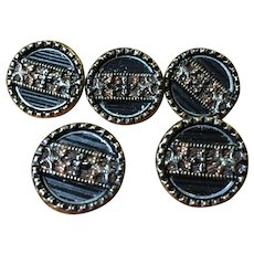 Vintage matched set of five metal buttons