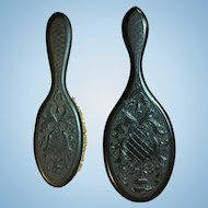 Victorian matching hand mirror and brush set.