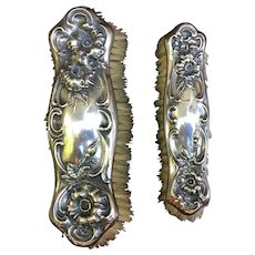 Sterling silver matching clothes brushes