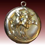 Vintage lily locket by W.H & CO
