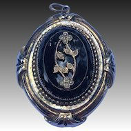 Victorian style locket with photos