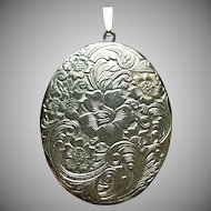 Vintage Sterling silver floral design locket