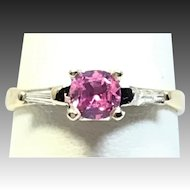 Vintage natural pink sapphire and diamond engagement ring