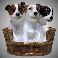 Royal Doulton A basket of puppies HN 2588