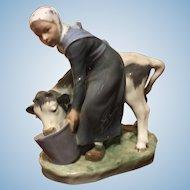 Royal Copenhagen porcelain figure of a young maiden feeding her cow