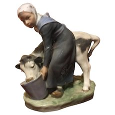 Royal Copenhagen porcelain figure of a young maiden feeding her cow