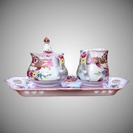 Sorelle porcelain sugar and creamer on a tray